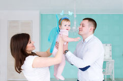 The father, mother and their little daughter play in room. Royalty Free Stock Images