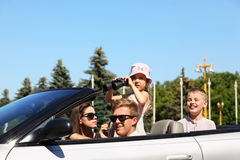 Father, mother and two children ride in car Royalty Free Stock Photography