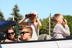 Father, mother and two children ride in car Royalty Free Stock Images