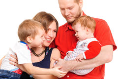 Father, mother and two sons. Studio shot Royalty Free Stock Images