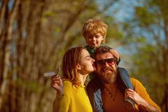 Father and mother walk with son, family love. Family love is in autumn park outdoor. Carefree time together.  stock photo