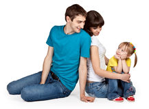 Father, mother and young daughter in jeans Stock Photos