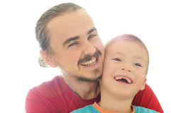 Father nad son happy smiling. In sunbeam royalty free stock photo