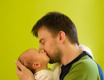 Father with newborn. Five weeks baby kised by its father royalty free stock images