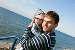Father with newborn. Father with his son on sea side stock images