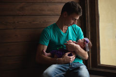 Father with newborn baby in hands Stock Images