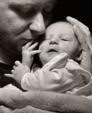 Father and newborn baby. Stock Photos