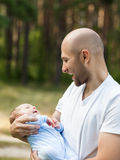 Father and newborn baby son walking outdoor Stock Photos