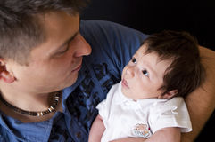Father and newborn son. Portrait of a newborn son looking at his father royalty free stock photos