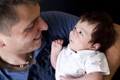 Father and newborn son Stock Image
