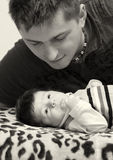 Father and newborn son. Portrait of a father looking at his newborn son Stock Photo