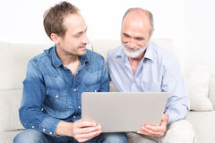 Father and older son. Looking at laptop Stock Photography