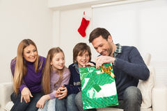 Father open his present with his family Royalty Free Stock Photography