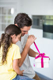 Father opening gift given by daughter Royalty Free Stock Photos