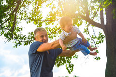 Father pampered baby. Father pampered baby in the park. Family happiness Stock Photography