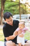 Father parenting baby on park Stock Photos