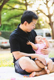 Father parenting baby on park Stock Image