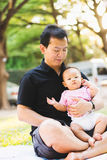 Father parenting baby on park Stock Photo