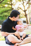 Father parenting baby on park Royalty Free Stock Photography