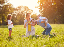 Father piggyback young boy. In green nature Stock Photography