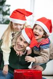 Father Piggybacking Children During Christmas Stock Photos