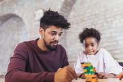 Father play educational games with his daughter. Having fun Royalty Free Stock Image