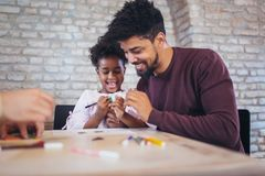 Father play educational games with his daughter. Having fun Royalty Free Stock Photo
