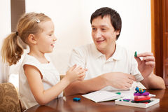Father play with girl Stock Images