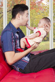 Father play with his baby in the living room Stock Photography