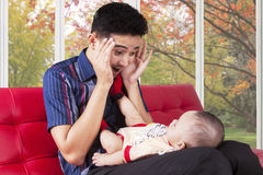 Father play peekaboo with his baby Stock Image
