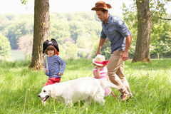 Father Playing Adventure Game With Children. Father Playing Exciting Adventure Game With Children And Dog In Summer Field Royalty Free Stock Photography