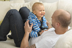 Father playing with baby son Stock Photography