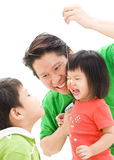 Father playing with children. A Asian father holding a toy and playing with this children.  White background Royalty Free Stock Image