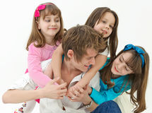 Father playing with children Stock Photos