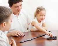 Father playing with children Royalty Free Stock Image