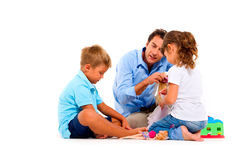 Father playing with children Stock Photography