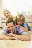 Father Playing With Children At Home Royalty Free Stock Photography