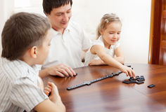 Father playing with children at home Stock Photo