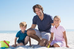Father playing with children Stock Images