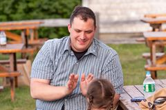 Father playing clapping game with his daughter Royalty Free Stock Photo