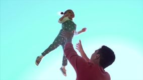 Father playing with daughter girl throwing in the air. Clip. Happy active child kid. Father throws his daughter