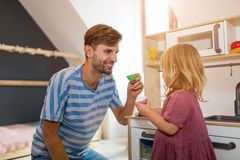 Father Playing with Daughter At Home royalty free stock photography