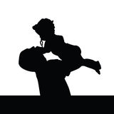 Father playing with daughter silhouette Stock Photography