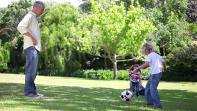 Father playing football with his children Stock Photo