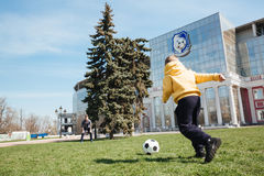 Father playing football with his little son outdoors in park. Picture of father playing football with his little son outdoors in the park royalty free stock photography