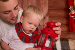 Father playing with her child in christmas Royalty Free Stock Image