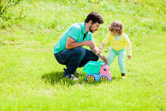 Father playing with his adorable toddler daugher. Family leisure Stock Photo
