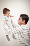 Father playing with his baby son Royalty Free Stock Photos