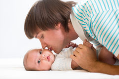 Father playing with his cute baby Royalty Free Stock Photos