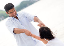 Father playing with his daughter Stock Photography